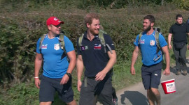 Prince Harry walks with wounded veterans, Dan Marino