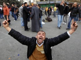 Image: A protester gestures in Tahrir square during an anti-government demonstration in Cairo