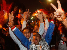 Image: Opposition protesters celebrate Egypt's President Hosni Mubarak's resignation, from their stronghold of Tahrir Square in Cairo