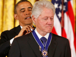 Image: U.S. President Barack Obama presents the Presidential Medal of Freedom to former U.S. President Bill Clinton at a ceremony in the East Room of the White House in Washington