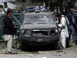Image: Afghan security forces personnel investigate the site of an explosion in Kabul