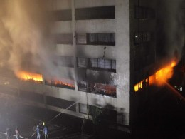 Image: Firefighters work to control a fire at a factory belonging to Tung Hai Group, a large garment exporter, in Dhaka