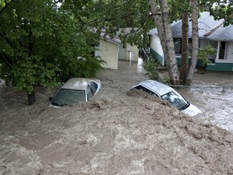Image: Cars are submerged by the flood waters in High River, Alberta