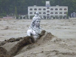Image: A submerged statue of the Hindu Lord Shiva stands amid the flooded waters of river Ganges at Rishikesh in Uttarakhand