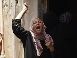 Image: A relative of Al-Mes-hal mourns during his funeral in Shati refugee camp in Gaza City