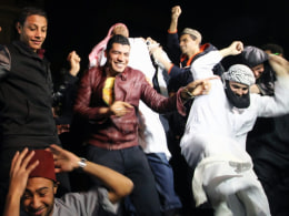 Image: Egyptian activists, and anti Muslim brotherhood perform the Harlem Shake