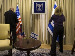 Image: Employees arrange Israeli and U.S. flags at the residence of Israel's President in Jerusalem, ahead of U.S. President Obama