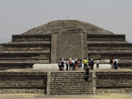 Image: Visitors look on at the archaeological area of the Quetzalcoatl Temple near the Pyramid of the Sun at the Teotihuacan  archaeological site, about 60 km (37 miles) north of Mexico City