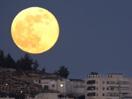 Image: Full supermoon rising over Har El neighborhood of Jerusalem