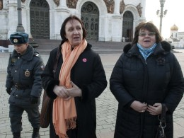 Image: Police escort university professors Yelena Volkova and Irina Karatsuba after detaining them inside the Christ the Saviour Cathedral in Moscow