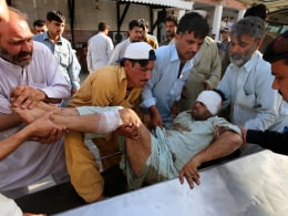 Image: Bombings at mosques kill at least 13 in Pakistan