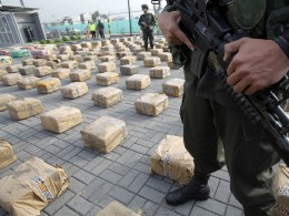Image: Anti-narcotics police officers stand guard near packages of marijuana that are displayed during a news conference at a police base in Bogota