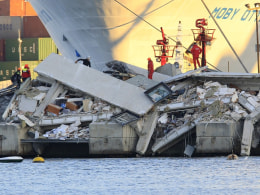 Image: The collapsed control tower is pictured at Genoa's port harbour
