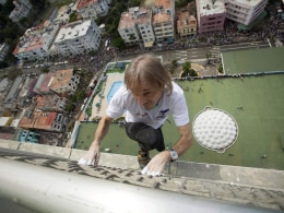 "Image: Alain Robert of France, who is known as ""Spiderman"", climbs up the Habana Libre hotel in Havana"