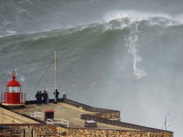 Image: Big-wave surfer Garrett McNamara drops in on a large wave at Praia do Norte in Nazare