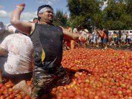 "Image: Revellers play with tomatoes during a ""Tomatina"" in Quillon town near Concepcion city, south of Santiago"