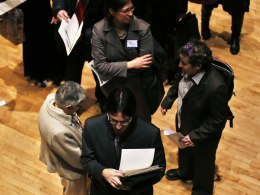 Image: File photo of people waiting in line to meet a job recruiter at the UJA-Federation Connect to Care job fair in New York