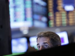 Image: A trader watches his screen on the floor at the New York Stock Exchange