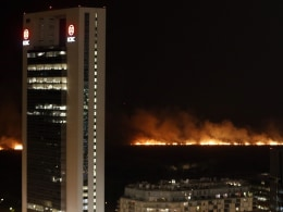 Image: Fire rages across the ecological reserve behind the Buenos Aires docks