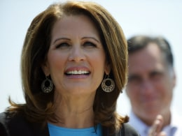 Image: File image of Bachmann speaking next to Romney during a rally at Crofton Industries in Portsmouth