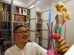 Image: Doll collector Jian Yang talks about the first doll that started his collection at his home in Singapore