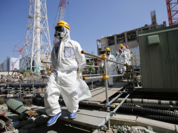Image: Members of the media are seen during a press visit to Fukushima nuclear plant