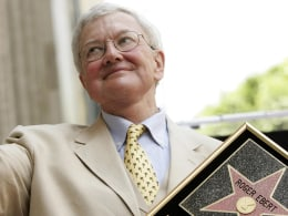 Image: Movie critic Roger Ebert gives the thumbs-up after receiving a star on the Hollywood Walk of Fame