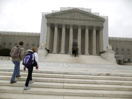Image: Tourists walk in front of the Supreme Court building in Washington