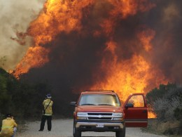 Image: Photographers take pictures of a raging wildfire pushing towards the coast in Camarillo
