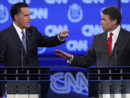 Image: GOP candidates Mitt Romney and Rick Perry take part in Tuesday's debate in Las Vegas