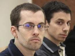 Image: File photo of American hikers Shane Bauer and Josh Fattal attending the first session of their trial in Tehran