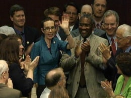 Image: Video grab of U.S. Rep. Giffords waves on the floor of the House of Representatives in Washington