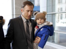 Image: Olympic alpine skier Bode Miller arrives with his son at Manhattan's Family Court
