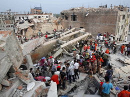 Image: Rescue workers try to rescue trapped garment workers in the Rana Plaza building which collapsed, in Savar