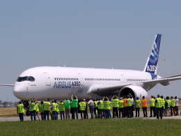 Image: The Airbus A350 lands after its maiden flight at Blagnac airport near Toulouse, southwestern France.