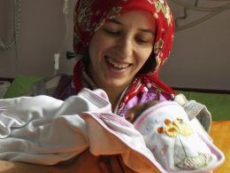 Image: Earthquake survivor Semiha Karaduman holds her two-week old baby girl Azra at a hospital in Ankara