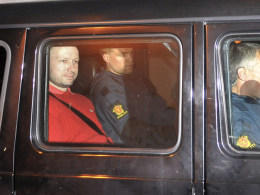 Image: Norwegian Breivik, man accused of a killing spree and bomb attack in Norway, sits in the rear of a vehicle as he is transported in a police convoy in Oslo