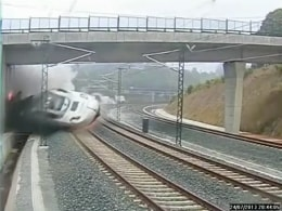 Image: A train derails in this still image from the video of a security camera near Santiago de Compostela,