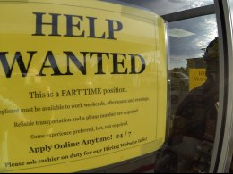 Image: A help wanted sign is posted on the door of a gas station in Encinitas, California