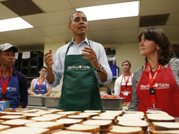 Image: U.S. President Obama speaks as he lends a hand during a visit to Martha's Table in Washington