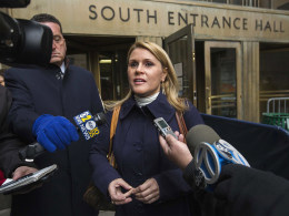 Image: Genevieve Sabourin, the woman accused of stalking actor Alec Baldwin speaks to the media during a break in her trial at Manhattan Criminal court in New York