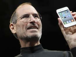 Image: File photo of Apple CEO Steve Jobs posing with the new iPhone 4 during the Apple Worldwide Developers Conference in San Francisco, California