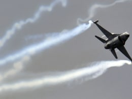 Image: A General Dynamics F-16 Fighting Falcon fighter jet performs during an air display at the Farnborough Airshow in Farnborough