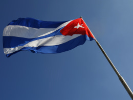 A Cuban flag flutters above Revolution S