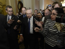 Image: US Senate Majority Leader Democrat Harry Reid leaves a meeting with US Senate Minority Leader Mitch McConnell