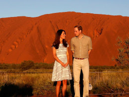 Image: Britain's Prince William and his wife Catherine, Duchess of Cambridge, pose in front of the Uluru
