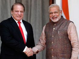 Image: India's Prime Minister Modi shakes hands with his Pakistani counterpart Sharif before the start of their bilateral meeting in New Delhi
