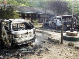 Image: Wreckages of burnt cars are seen outside the Mpeketoni police station after unidentified gunmen attacked coastal Kenyan town of Mpeketoni