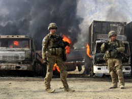 Image: Suicide bombers attack logistics compound in eastern Afghanistan
