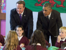 Image: British Prime Minister David Cameron and U.S. President Barack Obama speak with school kids